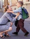 Woman hugging boy with backpack